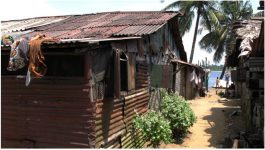 Corrugated iron house by the sea